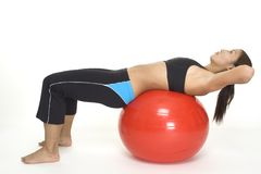 Fitball Crunch 1. A female fitness instructor demonstrates the starting position of the fitball crunch Stock Photo