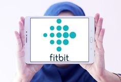 Fitbit company logo. Logo of Fitbit company on samsung tablet holded by arab muslim woman. Fitbit is an American company known for its products of the same name Stock Photo