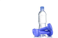 Fitnes symbols - blue dumbbells, a bottle of water and a towel. The concept of a healthy lifestyle Royalty Free Stock Images
