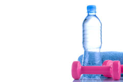 Fitnes symbols - Pink dumbbells, a bottle of water and a towel. The concept of a healthy lifestyle Stock Photo