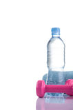 Fitnes symbols - Pink dumbbells, a bottle of water and a towel. The concept of a healthy lifestyle Stock Images