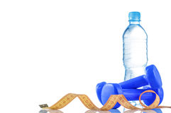 Fitnes symbols - red dumbbells, a bottle of water and a towel. The concept of a healthy lifestyle Stock Photo