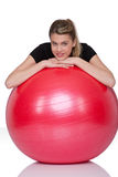 Fitness – Young woman with exercise ball on whit Stock Images
