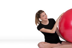 Fitness – Young woman with exercise ball on whit Royalty Free Stock Photography
