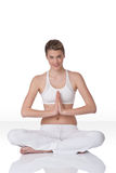 Fitness – Young woman in yoga position on white Royalty Free Stock Photography