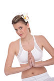 Fitness – Young woman in yoga position on white Stock Photography