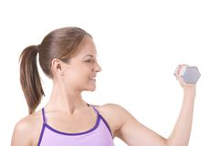 Fitness. Woman on white holding silver dumbbells Royalty Free Stock Image