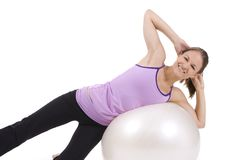 Fitness. Young woman on white background in a fitness pose Royalty Free Stock Images