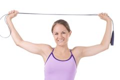 Fitness. Woman on white holding a jump rope Royalty Free Stock Images