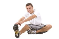 Fitness. Man on a white background in a fitness pose Stock Images