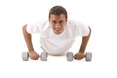Fitness. Man on white background doing push ups Royalty Free Stock Photo