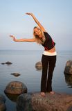 Fitness. Fit girl working out at the seashore Stock Photo
