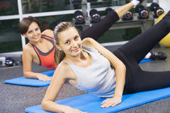 Fitness. Portrait of young nice women getting busy in gym Stock Photo