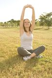 Fitness. Young woman outside in a fitness pose Stock Photo