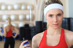 Fitness. Young sporty woman in the gym centre stock images
