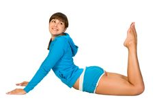 Fitness. Attractive young woman is doing some exercises Royalty Free Stock Images