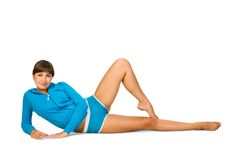 Fitness. Attractive young woman is doing some exercises Stock Photography