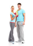 Fitness. Smiling young  strong man and woman. Isolated over white background Royalty Free Stock Image