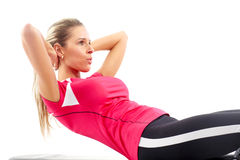 Fitness. Smiling woman working out. Isolated over white background Royalty Free Stock Photos