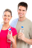 Fitness. And gym. Smiling young  strong man and woman. Isolated over white background Royalty Free Stock Image