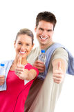 Fitness. And gym. Smiling young  strong man and woman. Isolated over white background Stock Photos