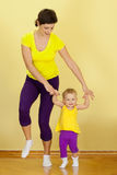 Fitness. Mother does fitness exercises together with her baby Royalty Free Stock Images
