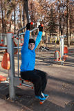 Fitness. Man doing exercise outdoors in a public park Royalty Free Stock Images