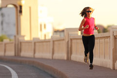 Fitness. A beautiful athletic woman running in an urban environment Stock Photography