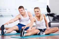 Fitness. Young people in the fitness club Stock Photography