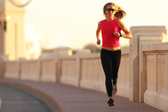 Fitness. A beautiful athletic woman running in an urban environment Royalty Free Stock Photo