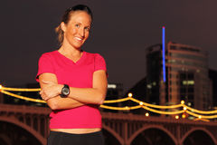 Fitness. A beautiful athletic woman poses after running in an urban environment stock photos