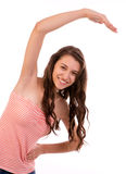 Fitness. A young pretty woman stretching.  Young woman in training figure Royalty Free Stock Photography