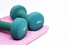 Fitness. Concept - dumbbells  and towel Royalty Free Stock Photo