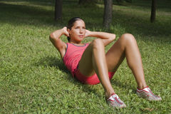 Fitness. Young girl doing fitness outdoor in a park Royalty Free Stock Images
