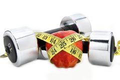 Fitness. Weight  apple and a tape measure Royalty Free Stock Photography