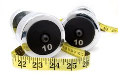 For fitness. Weights and a measure tape Royalty Free Stock Image