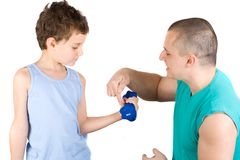 Fitness. 8 years old boy doing fitness with his father as a coach Stock Photo