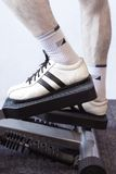 Fitness. Man's Legs On A Fitness Machinery Royalty Free Stock Photography