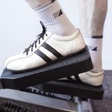 Fitness. Man's Legs On A Fitness Machinery Stock Photos