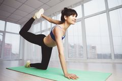 Woman work out performing static stretching exercise stock photos