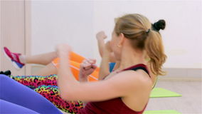 Fitness. Aerobics on the floor stock footage