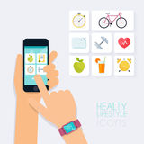 Fitness app concept on touchscreen. Mobile phone and tracker on Royalty Free Stock Images