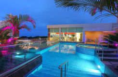 Fitness area with outdoor swimming pool in the sunset.  Royalty Free Stock Photo