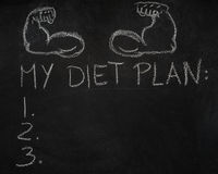 Fitness arms and My diet plan list on black chalkboard Royalty Free Stock Photos