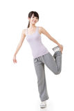 Fitness asian girl doing stretch exercise Stock Image