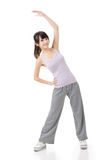 Fitness asian girl doing stretch exercise Royalty Free Stock Image