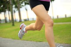 Fitness asian woman legs running stock photos
