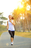 Fitness asian woman running Royalty Free Stock Photo