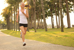 Fitness asian woman running Royalty Free Stock Photos