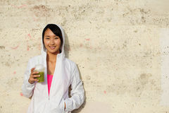 Fitness asian woman taking a rest for drinking detox smoothie. Asian sporty woman taking fitness workout rest for drinking healthy fitness detox smoothie. Happy Royalty Free Stock Images